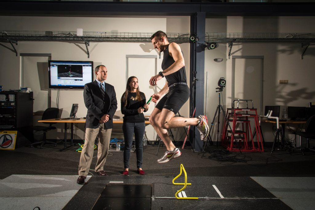 Heather Bansbach, a doctoral student at the Pitt Neuromuscular Research Laboratory, conducts a demonstration of the portable motion capture plaform she is developing under the tutelage of assistant professor Timoth Sell (left).